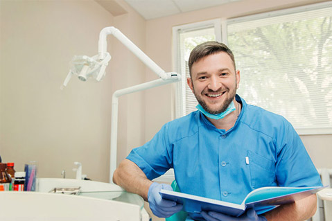 Male dentist sitting in office